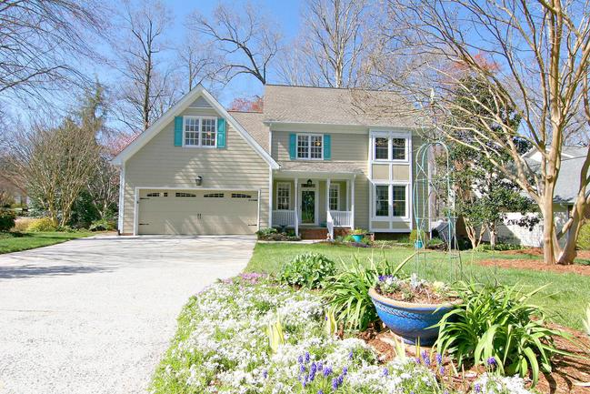 Completely UPDATED Lochmere beauty on quarter acre lot with lush landscaping.
