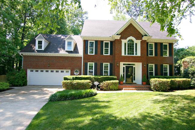 Updated CUSTOM brick-front home in desirable Lochmere Highlands. Home has large unfinished attic great for storage or future expansion.